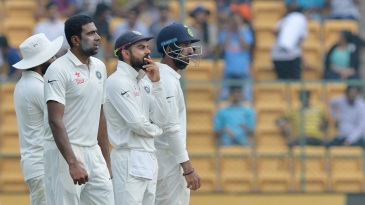 R Ashwin, Virat Kohli and Cheteshwar Pujara wait on a DRS review