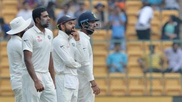 R Ashwin, Virat Kohli and Cheteshwar Pujara wait on a DRS review