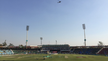 An army chopper oversees preparations at the Gaddafi Stadium