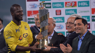 Peshawar Zalmi captain Darren Sammy accepts the PSL 2017 trophy