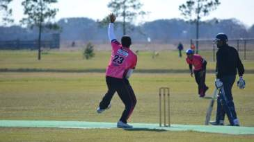 A bowler winds up to bowl in Houston's cricket league