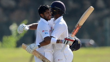Kusal Mendis is congratulated by Asela Gunaratne after raising his century