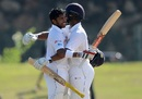 Kusal Mendis is congratulated by Asela Gunaratne after raising his century, Sri Lanka v Bangladesh, 1st Test, Galle, 1st day, March 7, 2017