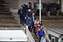 Fans evacuate from the main stand after a fire alarm, New Zealand v South Africa, 1st Test, Dunedin, 3rd day, March 10, 2017