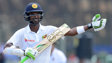 Upul Tharanga gestures after bringing up his century