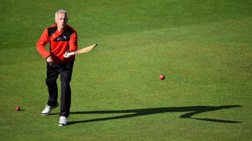 Peter Moores helps the players warm up