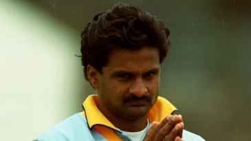 Javagal Srinath keeps warm during a warm-up match against Leicestershire