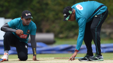 Mushfiqur Rahim and coach Chandika Hathurusingha inspect the pitch on the eve of the Test