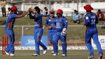 Rashid Khan celebrates a wicket with his team-mates