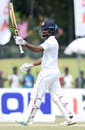 Dimuth Karunaratne raises his bat after scoring his fifth Test century, Sri Lanka v Bangladesh, 2nd Test, Colombo, 4th day, March 18, 2017