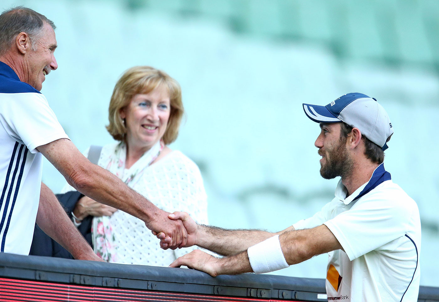 Maxwell talks to his parents, Neil and Joy, during a Shield game in Melbourne, 2015