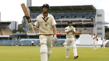 Adam Voges acknowledges the spectators as he walks off after declaring