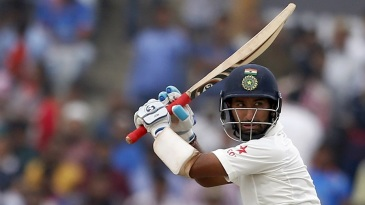 Cheteshwar Pujara watches the ball after playing a shot