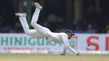 Dhananjaya de Silva dives to stop a ball