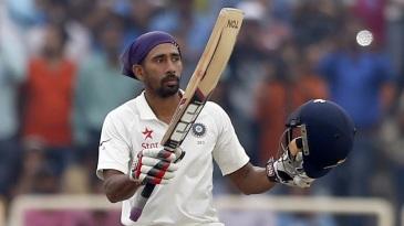 Wriddhiman Saha celebrates after reaching his ton