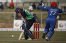 Mohammad Shahzad celebrates after Niall O'Brien loses his off stump, Afghanistan v Ireland, 3rd ODI, Greater Noida, March 19, 2017