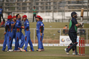 Mohammad Nabi celebrates with his team-mates after dismissing Paul Stirling, Afghanistan v Ireland, 3rd ODI, Greater Noida, March 19, 2017