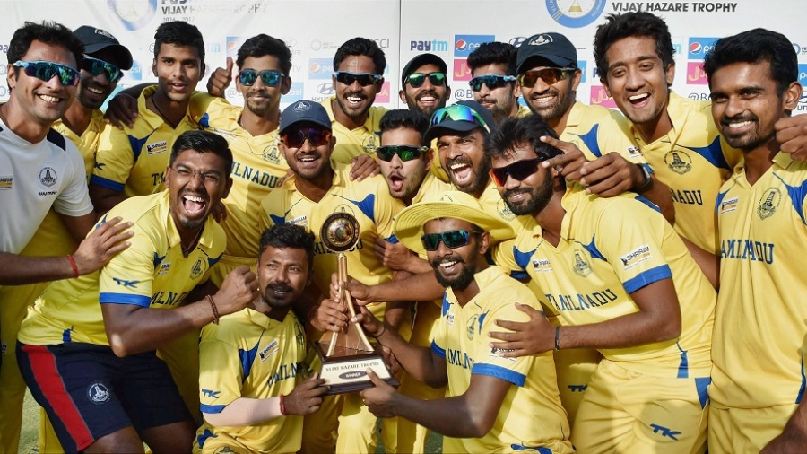 The Tamil Nadu players pose with the Vijay Hazare Trophy after their win
