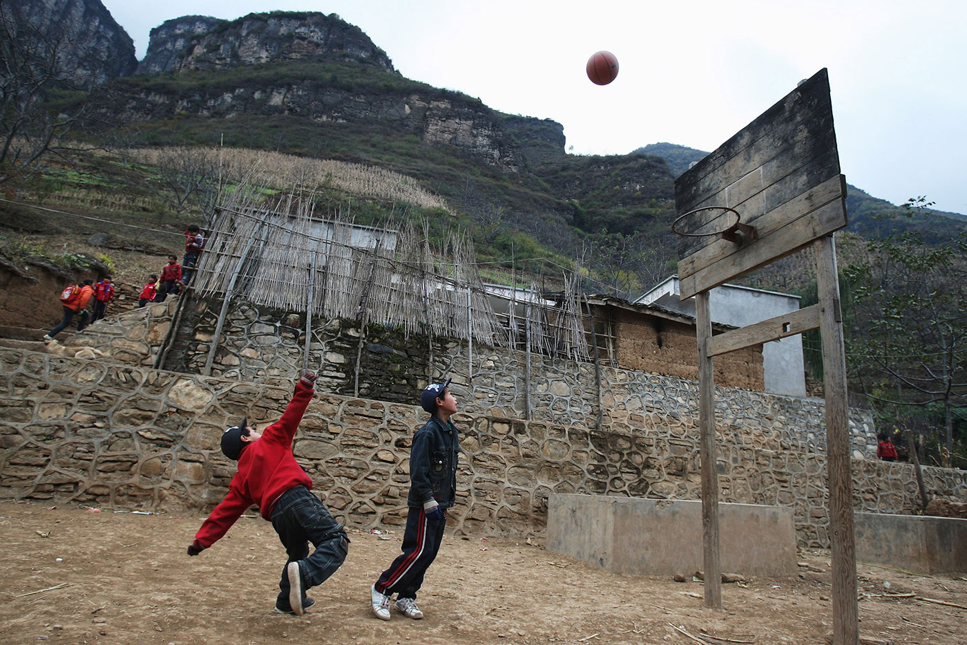 Kids play basketball in a village in the Sichuan province of China