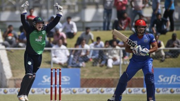 Gary Wilson successfully appeals for the wicket of Gulbadin Naib