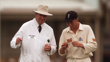Michael Atherton attends to the ball in Darrell Hair's presence