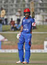 Rahmat Shah raises his bat after bringing up his half-century, Afghanistan v Ireland, 5th ODI, Greater Noida, March 24, 2017