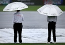 The umpires take shelter on a rainy day, New Zealand v South Africa, 3rd Test, Hamilton, 1st day, March 25, 2017