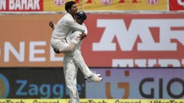 The Yadavs, Umesh and Kuldeep, celebrate a wicket