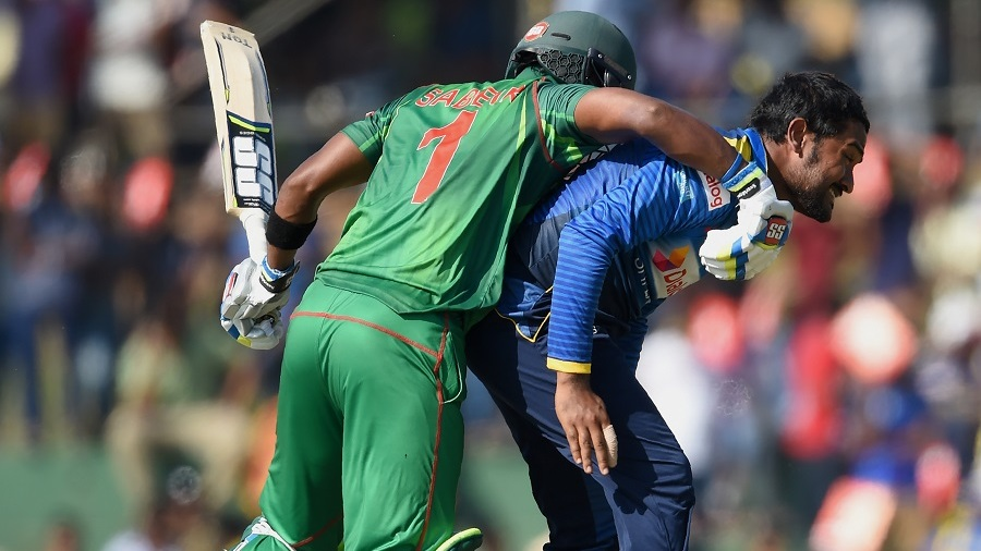 Collision course: Sabbir Rahman bangs into Sachith Pathirana while taking a run