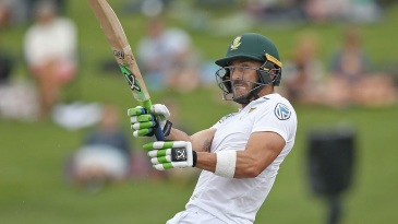 Faf du Plessis swivels after pulling the ball