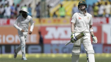 Steven Smith walks back after being bowled