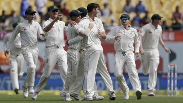 Australia's fielders celebrate after Cheteshwar Pujara's run out