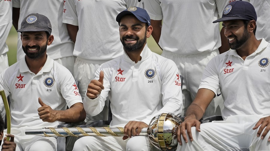 Ajinkya Rahane, Virat Kohli and R Ashwin smile for the cameras