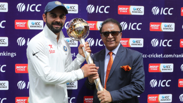 Virat Kohli receives the ICC Test mace from Sunil Gavaskar