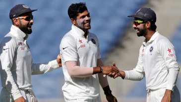 Umesh Yadav is congratulated by Ajinkya Rahane and Virat Kohli