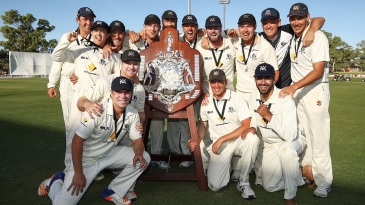 Victoria celebrate their third successive Sheffield Shield title