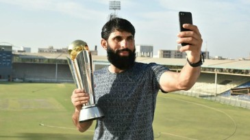 Misbah-ul-Haq poses with the ICC Champions Trophy