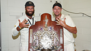 Rob Quiney (left) and Cameron White pose with the Shield