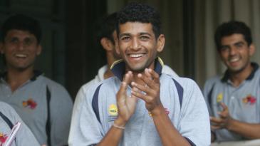 Amol Muzumdar applauds from the dressing room