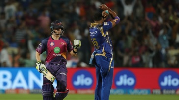 Steven Smith punches the air after hitting back-to-back sixes for victory