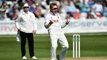 Simon Harmer celebrates his first wicket for Essex