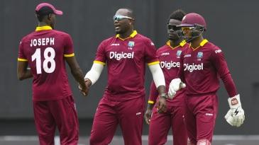 Ashley Nurse celebrates a wicket with team-mates