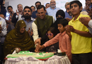 Younis Khan cuts a cake with his family at a press conference, following the announcement of his retirement from international cricket, Karachi, April 8, 2017