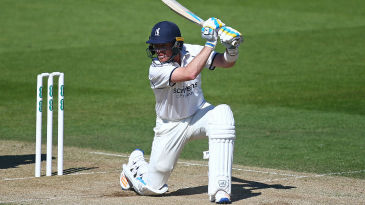 Ian Bell drives through the covers during his battling half-century