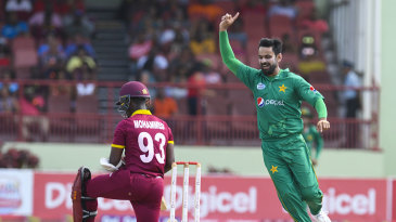 Mohammad Hafeez celebrates the wicket of Jason Mohammed