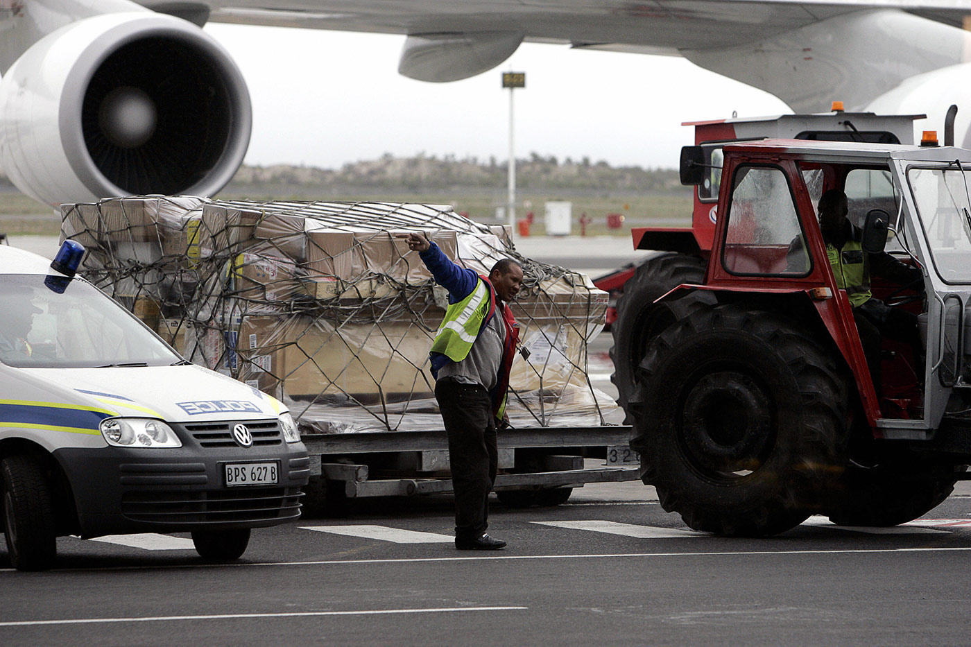 Woolmer's body is offloaded from a South African Airways 747 in Cape Town on April 29, 2007