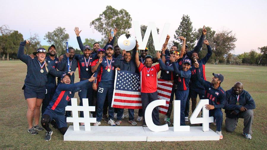 USA coach Pubudu Dassanayake raises the W for winning the WCL Division Four title