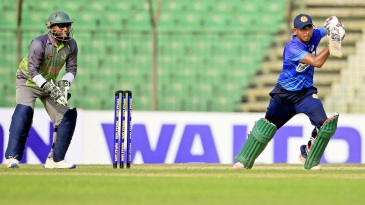 Mosaddek Hossain plays the ball on the up