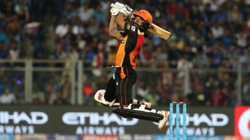 Shikhar Dhawan gets some hang-time as he slaps the ball for a four