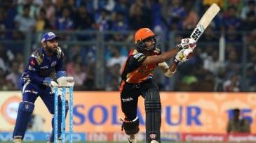 Deepak Hooda looks to muscle the ball away